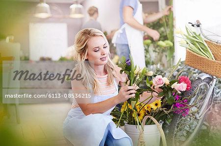 Florist selecting flowers in flower shop
