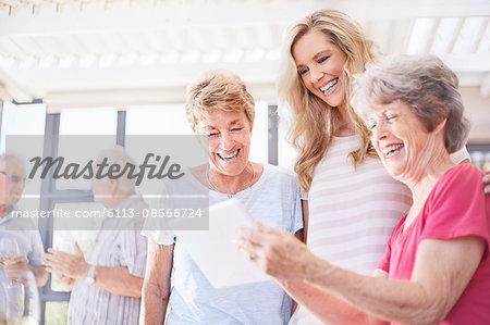 Senior women using digital tablet