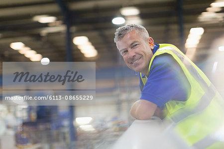 Portrait smiling supervisor in steel factory