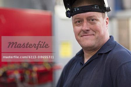 Portrait confident welder in steel factory