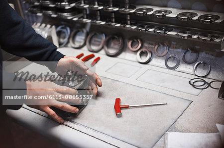 Worker assembling part in steel factory