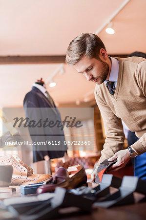 Businessman browsing socks in menswear shop