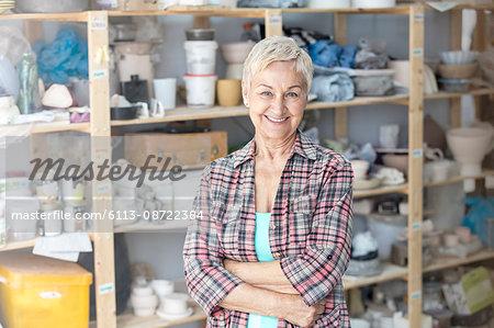 Portrait senior artist in pottery studio