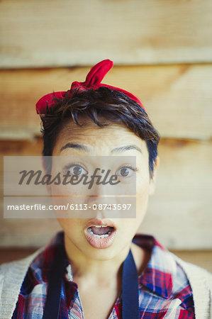 Close up portrait surprised woman