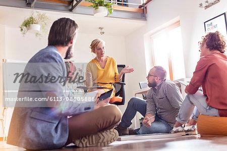 Design professionals meeting sitting on floor