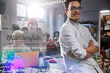 Portrait smiling, confident male designer in workshop