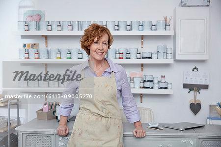 Portrait smiling, confident female business owner in art paint shop