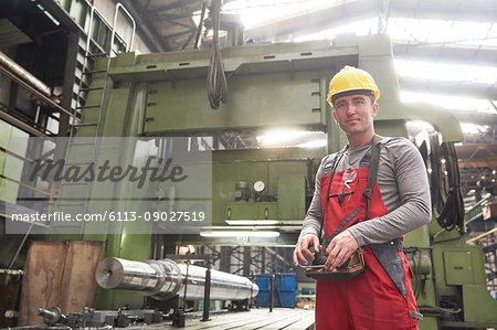 Portrait confident male worker working in steel factory