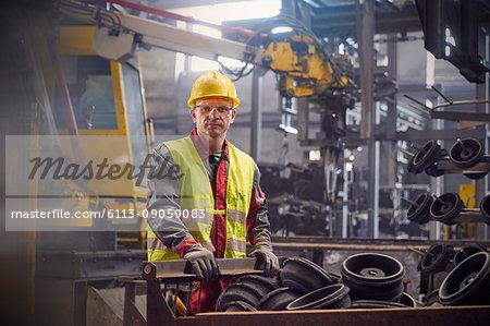 Portrait serious, confident steelworker in steel mill