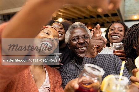 Happy multi-generation family posing for selfie