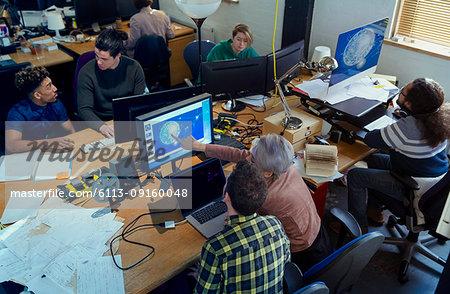 Creative designers working, meeting n open plan office