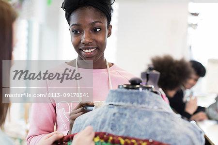 Smiling Teenage Girl Designing Denim Jacket In Fashion Design Class Stock Photo Masterfile Premium Royalty Free Code 6113 09178541