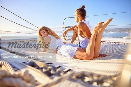 Portrait smiling woman relaxing on sunny catamaran