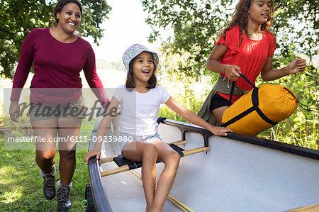 Happy family with canoe