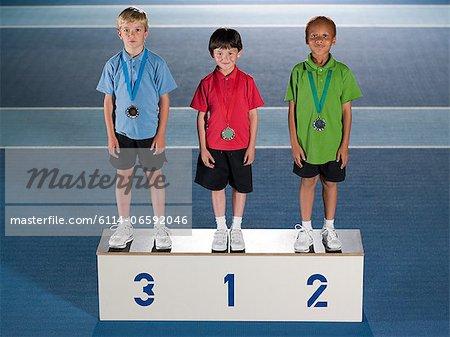 Boys on a podium