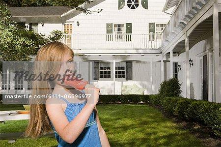 Girl eating an ice lolly