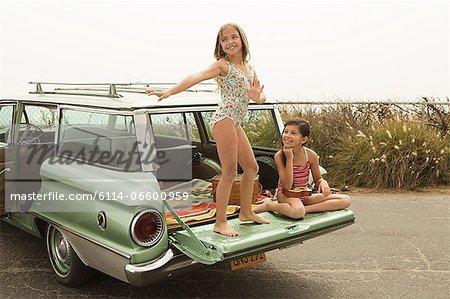 Girl dancing on car boot