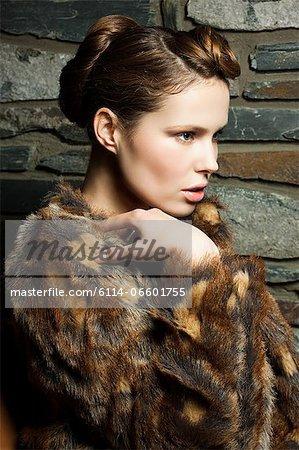 Young woman wearing fur coat, portrait