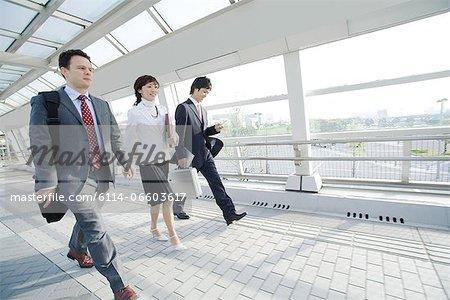 Businesspeople on walkway