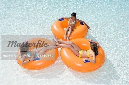 Girls in rubber rings