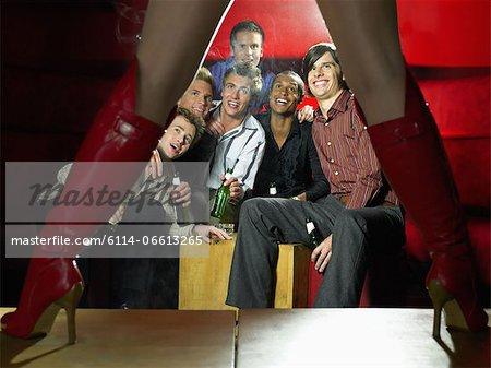 Men watching strip tease