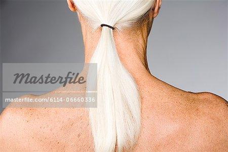 Senior woman with ponytail