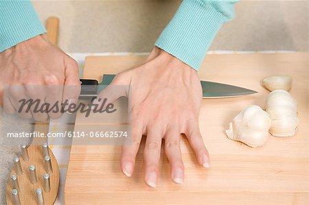 Person crushing garlic