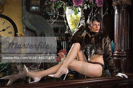 Woman in underwear reclining on a bar top