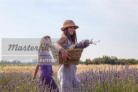 Young Women Walking Through Lavender Field, Croatia, Dalmatia, Europe