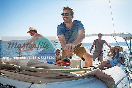 Croatia, Adriatic Sea, Young people on sailboat