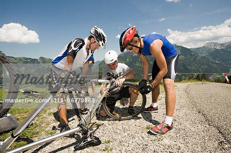 Mountain bikers Having Vehicle Breakdown, Sonthofen, Bavaria, Germany