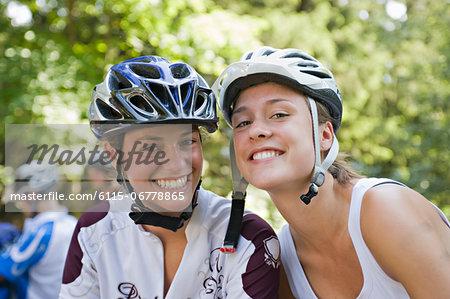Two Teenage Girls Wearing Bicycle Helmets, Sonthofen, Schattwald, Bavaria, Germany