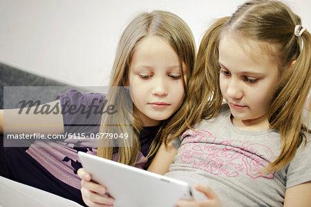 Two girls using digital tablet, Osijek, Croatia, Europe