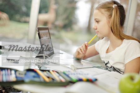 Girl using digital tablet, Osijek, Croatia, Europe