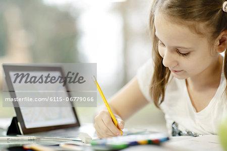 Girl using digital tablet and doing homework, Osijek, Croatia, Europe