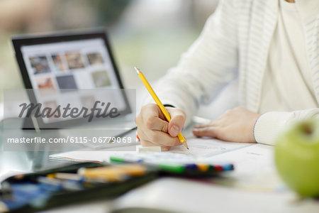 Boy using digital tablet and doing homework, Osijek, Croatia, Europe