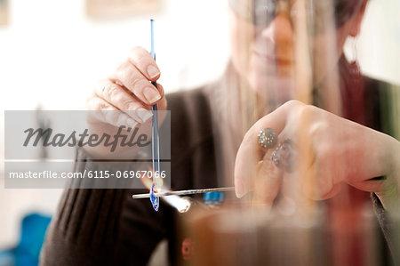 Craftswoman making beads, Augsburg, Bavaria, Germany