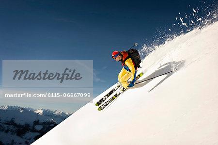 Backcountry skier skiing downhill, Alpbachtal, Tyrol, Austria, Europe