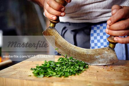 Person Chopping Fresh Herbs