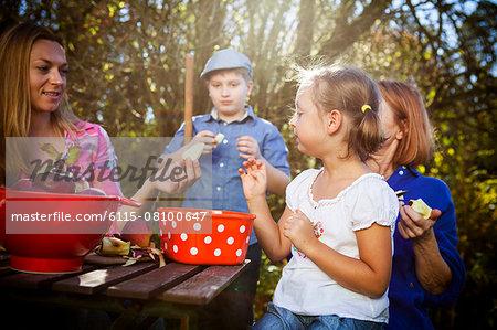 Multi-generation family peeling apples, Munich, Bavaria, Germany