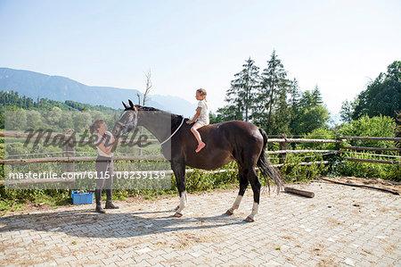 Little girl sitting on horseback