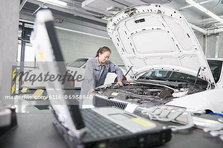 Female Mechanic working in Auto Repair Shop