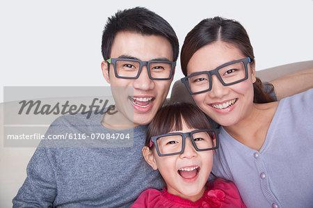 Portrait of Family wearing black glasses, studio shot