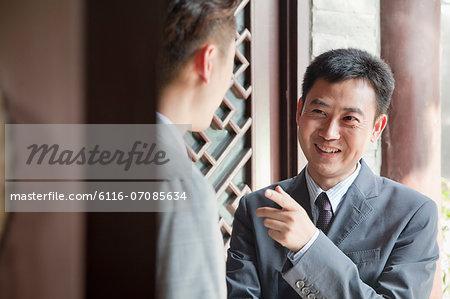 Businessmen in Doorway