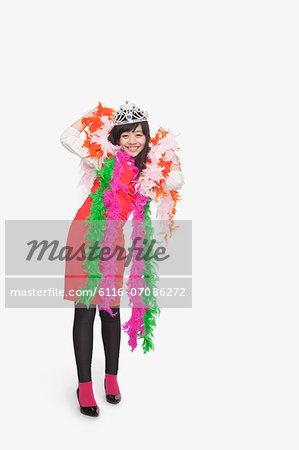 Girl wearing feather boas and tiara