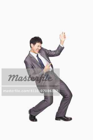 Businessman playing air guitar