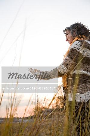 Mature woman holding a starfish