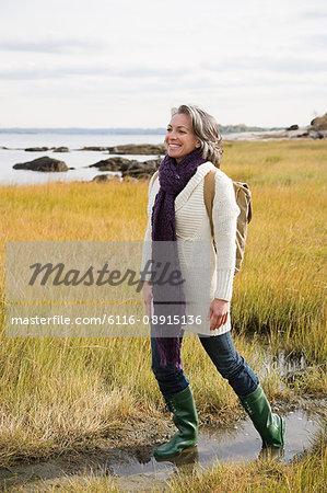 Mature woman walking on marshland