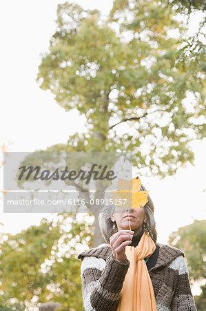 Mature woman holding a leaf