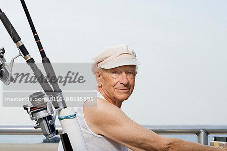 Senior man with fishing rod